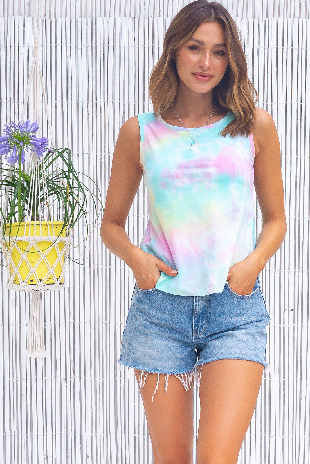 The Tali Top now comes in tie dye,  Tali Rainbow Tie Dye Tank Top is a classic tank top cut featuring slim fit over the bust, relaxed over the waist & hips and polyester blend in  pretty pale tie dye in many colours on a white base.