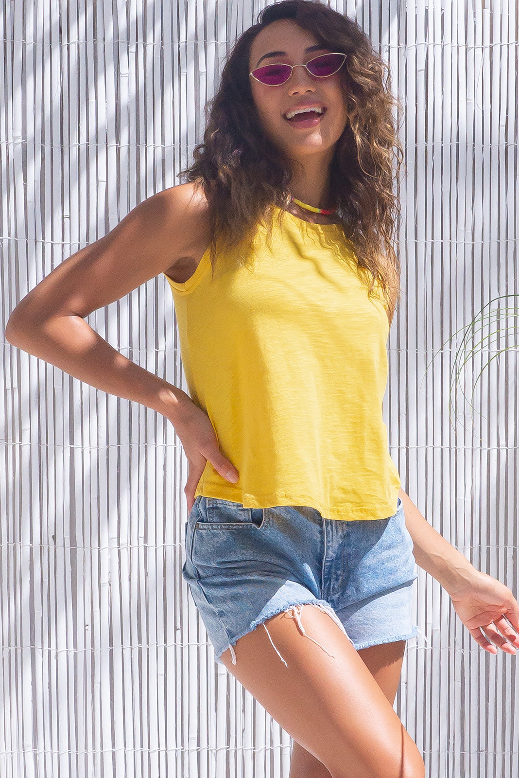 The Soleil Yellow Tank Top is a classic tank top featuring slim fit over the bust, relaxed over the waist & hips and 55% cotton, 45% polyester  in bright sunshine yellow colour.