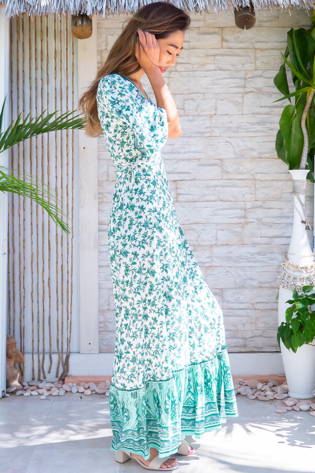 This bohemian frock, Tamara Fern Green Wrap Dress has short sleeves, flattering adjustable wrap design, frill hem with border print and white base with intricate mint and green print in woven 100% rayon.