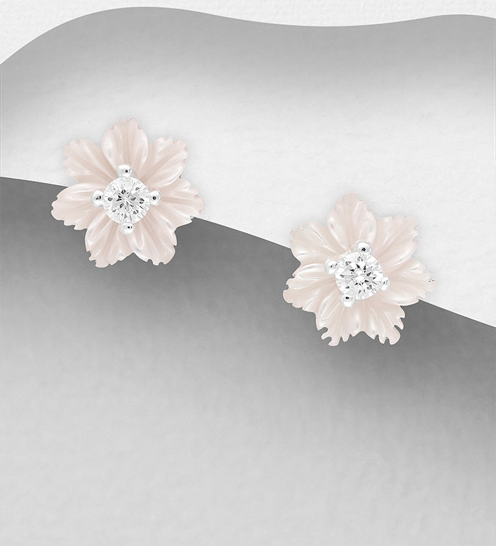 this lovely stud earring is carved from Mother of Pearl shell, the centre is a tiny crystal stud that can be worn without the flower