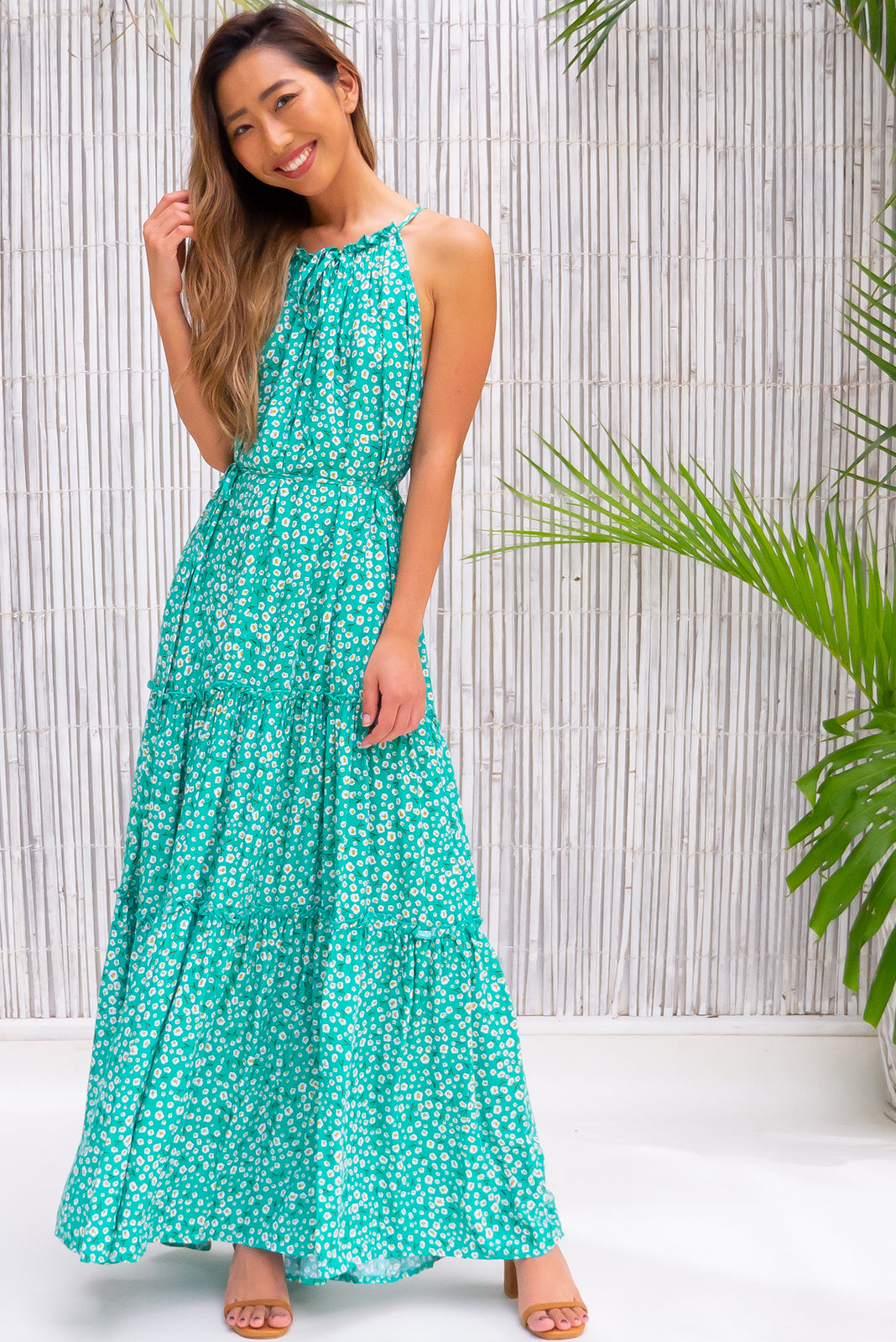 Tori Emerald Maxi Dress, such a gorgeous dress features strappy, high neckline, tie up keyhole in front neckline, waist tie, tiered skirt, emerald base with white ditzy floral print in woven 100% rayon.