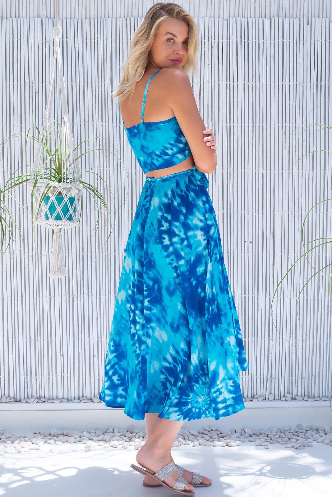 The Toucana Sea Splash Wrap Skirt features functional wrap around design, high/low hemline, elasticated back of waist, side pockets and 100% viscose in blue tie dye print