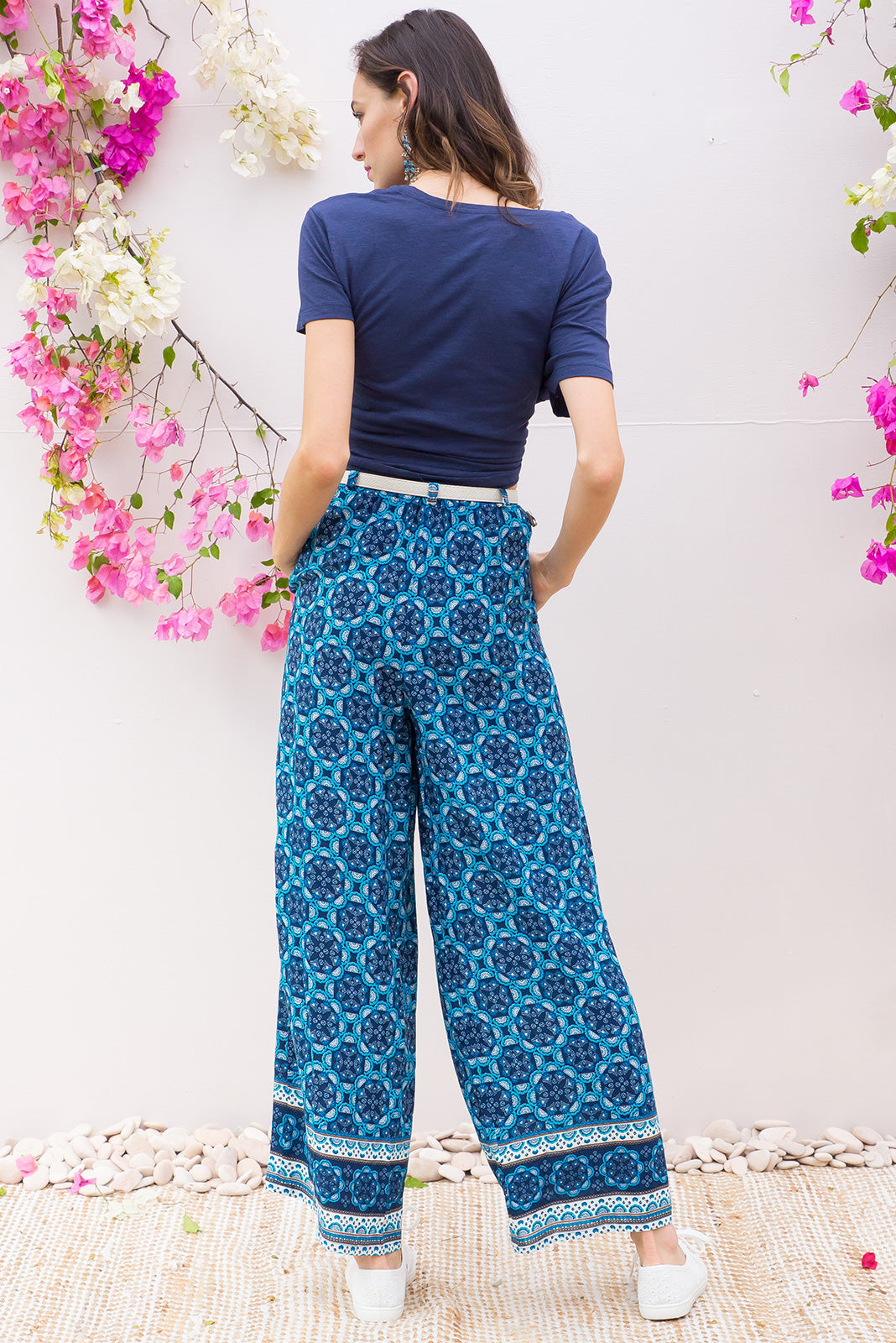 Traveller Pants Blue Bayou feature an elastic waistband, wide leg, relaxed fit in a gorgeous royal blue and turquoise eastern inspired boho border print on soft woven rayon
