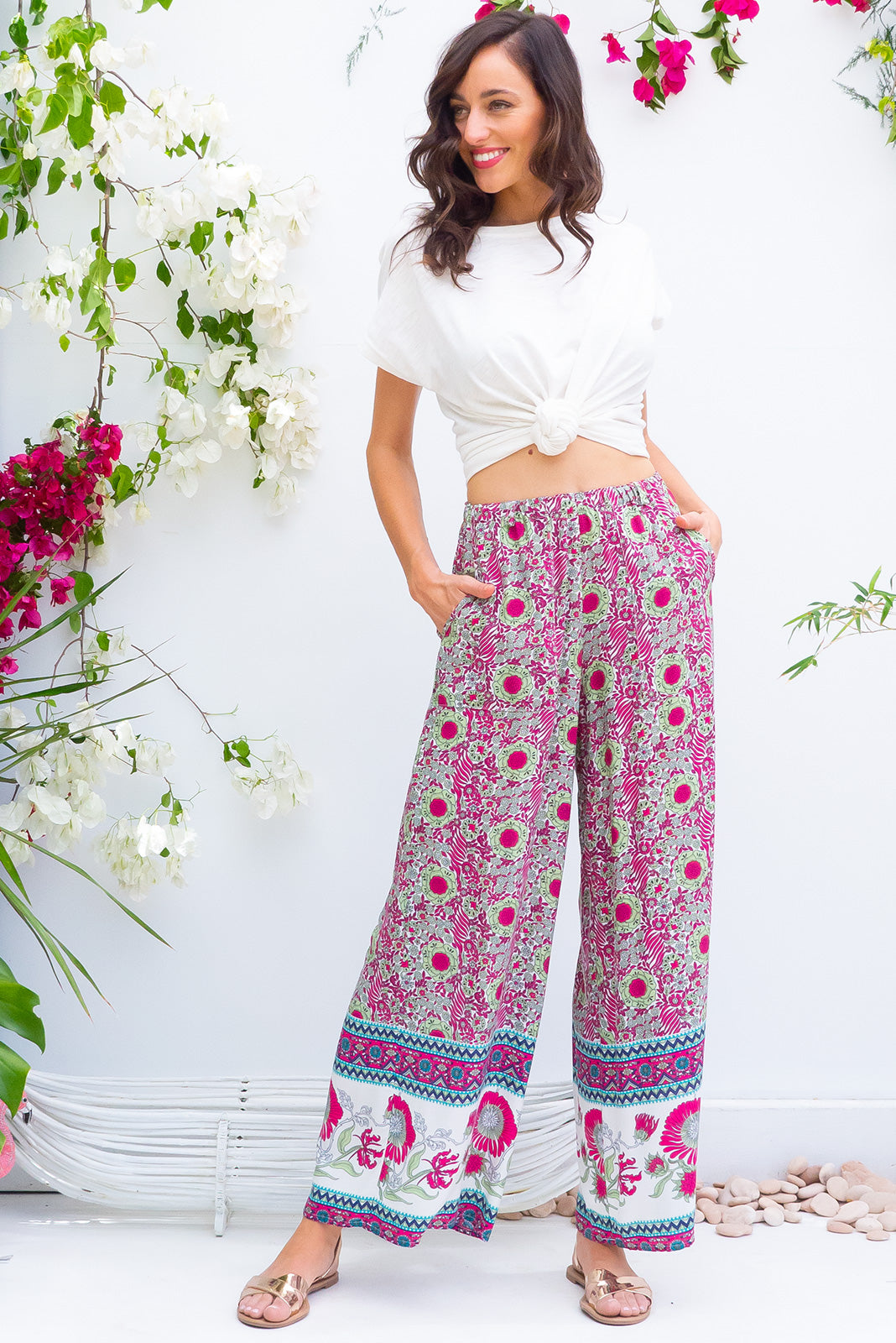 Traveller pants raspberry are wide leg pants with an elastic waist, deep pockets and they feature a gorgeous Moroccan boho inspired border print woven rayon