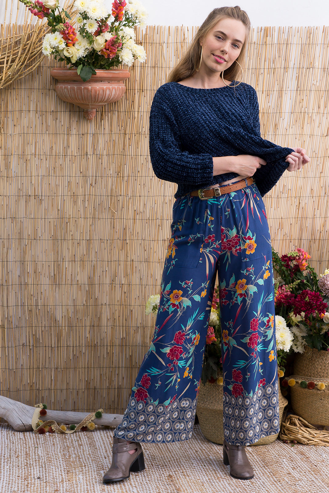 Traveller pants navy tropics are wide leg pants with an elastic waist, deep pockets and they feature a gorgeous tropical boho inspired border print on a dusky navy woven rayon, plus size pants