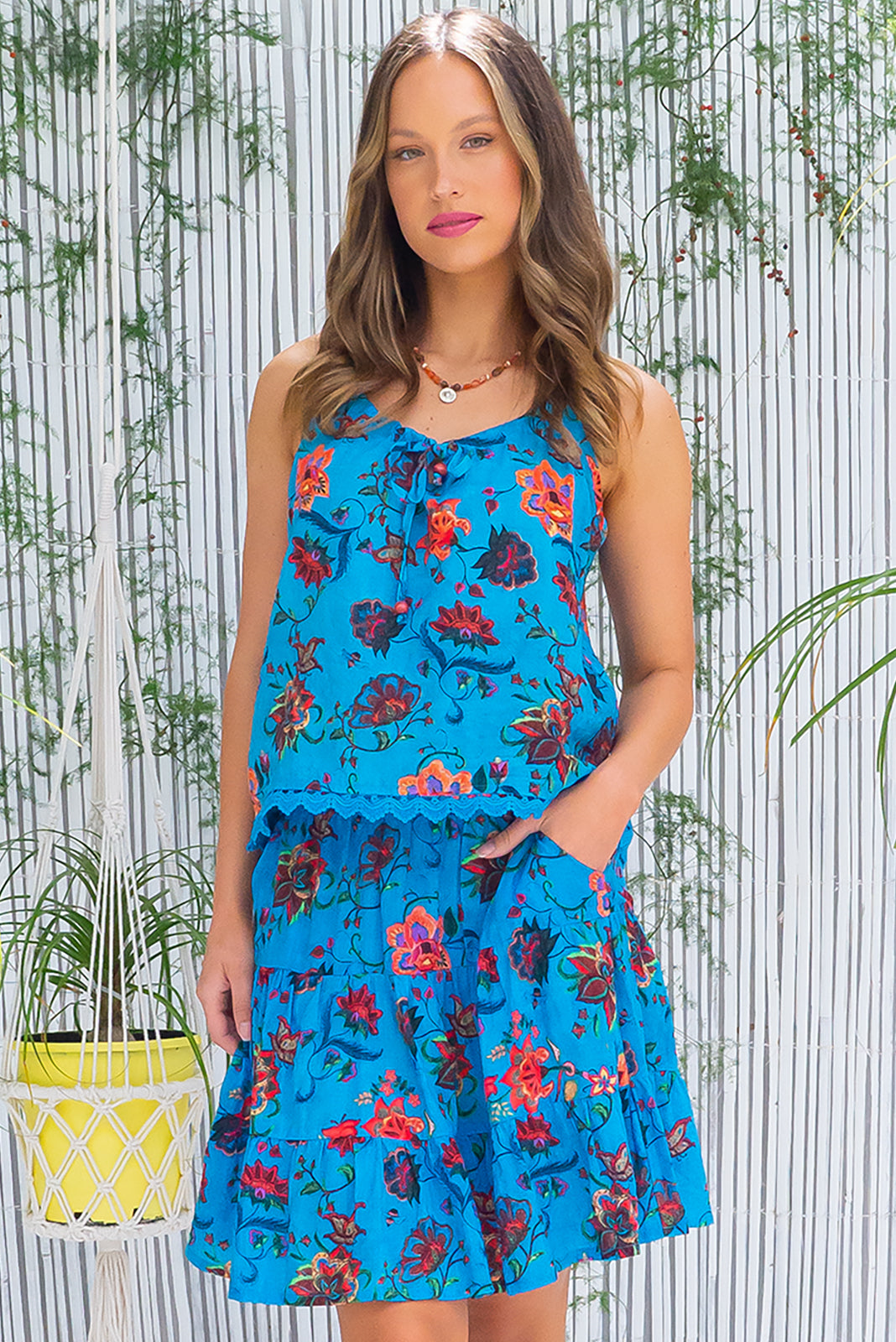 The Valencia Barrio Blue Cami Top has bead detail on neck ties, lace detail on hem and 65% cotton, 35% Viscose in blue base with large paisley print.