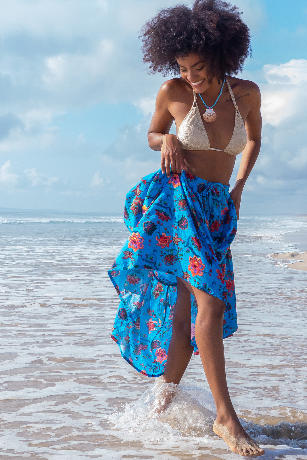 The Valencia Barrio Blue Maxi Skirt is a comfortable slip-on style maxi skirt featuring tiered for fullness, side pockets and 100% cotton in bright blue base with large paisley print.