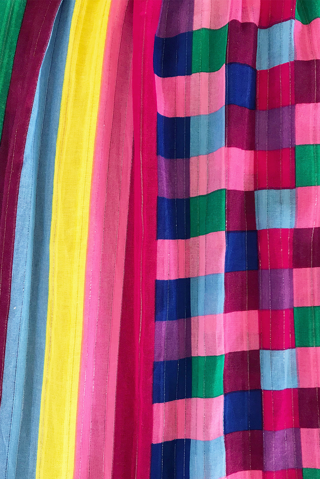 Fabric Swatch of Valencia Carnivale Maxi Skirt featuring a lurex thread running through it for a touch of summer sparkle, woven fabric 95% cotton 5% poly in bright multicoloured stripe and check print.
