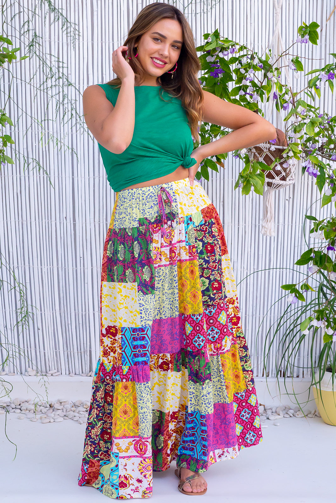 The Valencia Oasis Party Maxi Skirt features comfortable slip-on style, tiered for fullness, side pockets and 100% cotton in pink, blue and yellow multicoloured patchwork print.