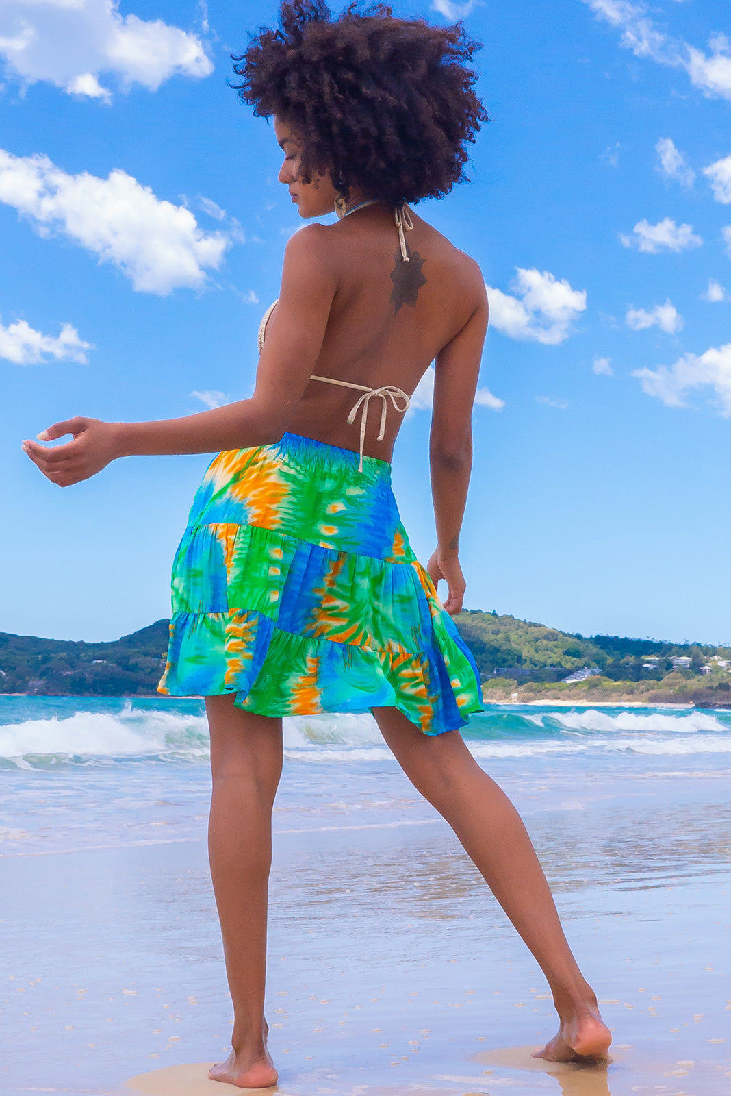 Perfect skirt for beach girls, the Valencia Ocean Tie Dye Mini Skirt features elasticated back waistband, tiered for flirty fullness, side pockets and 100% rayon in tie dye print with sky blue, sea green and sunshine yellow.