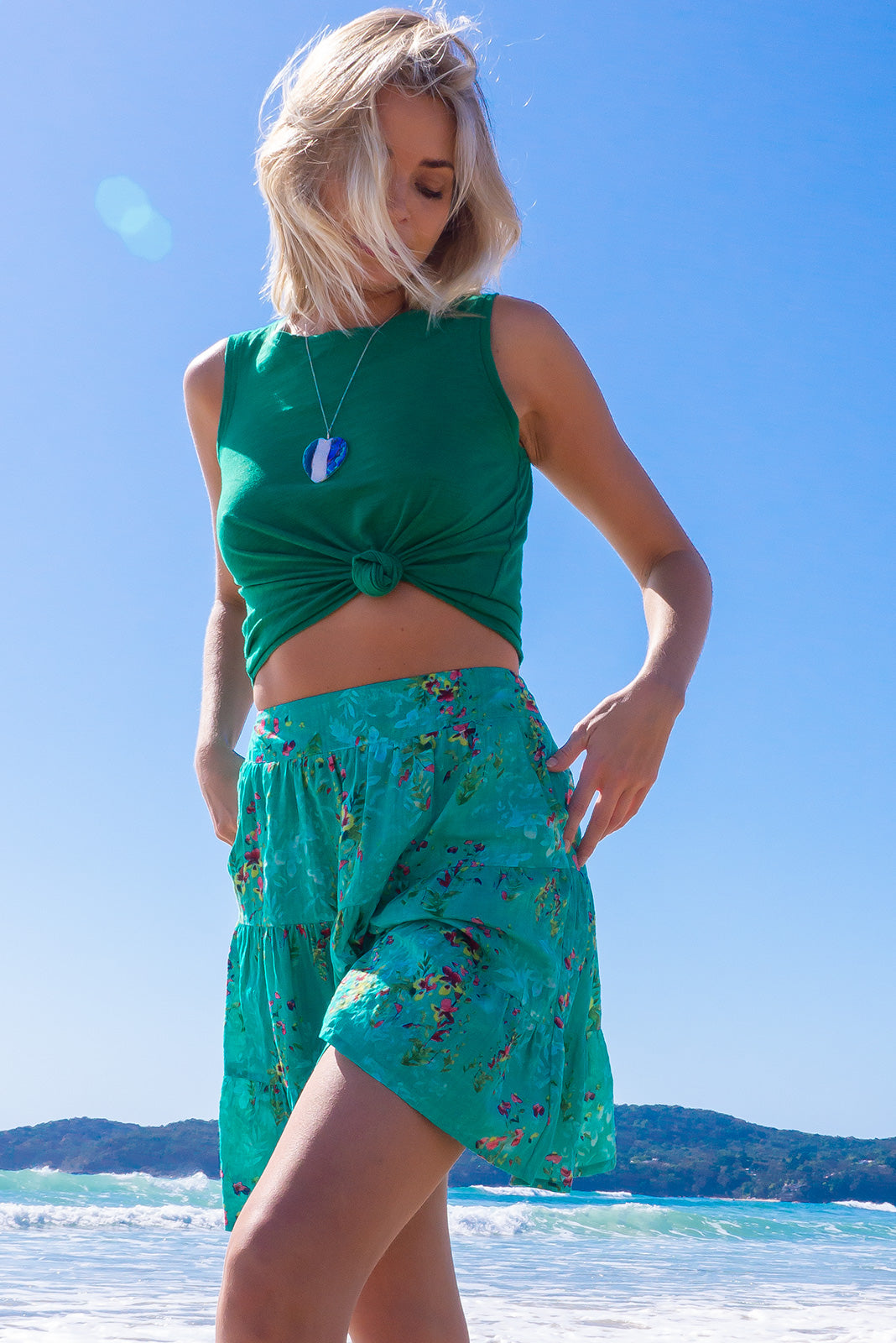 The Valencia Sea Glass Green Mini Skirt features elasticated back waistband, comfortable pull-on style, tiered for flirty fullness, side pockets and 100% cotton in green base with wash effect and watercolour print.