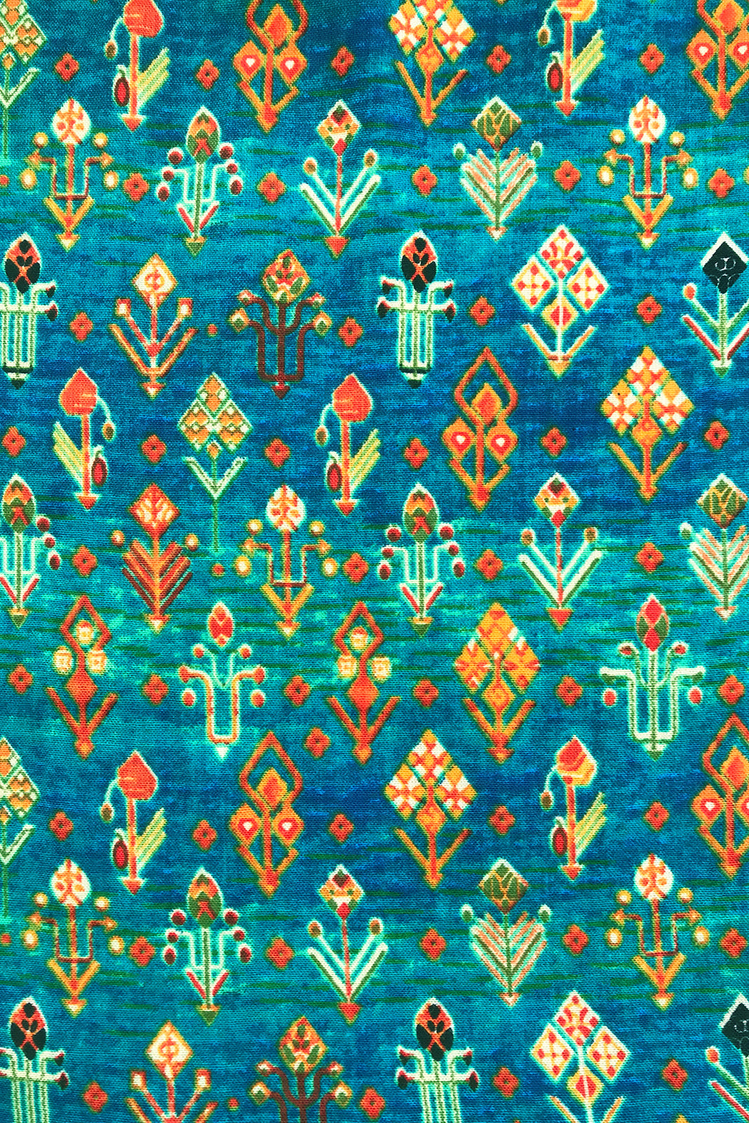 Fabric Swatch of Valencia Turquoise Aztec Maxi Skirt featuring cotton/ viscose blend in blue/green aztec print.