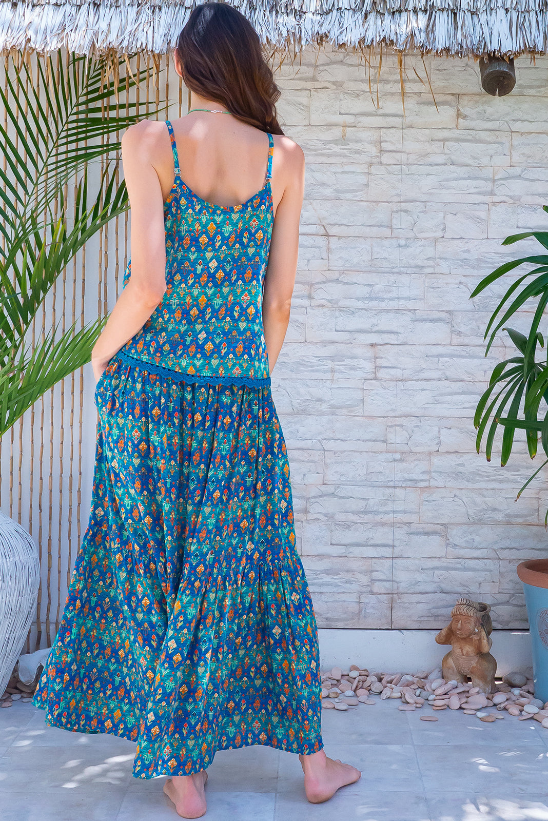 The Valencia Turquoise Aztec Maxi Skirt is made for you, featuring elasticated waistband with adjustable drawstring, tiered for fullness, side pockets and cotton/ viscose blend in blue/green aztec print.
