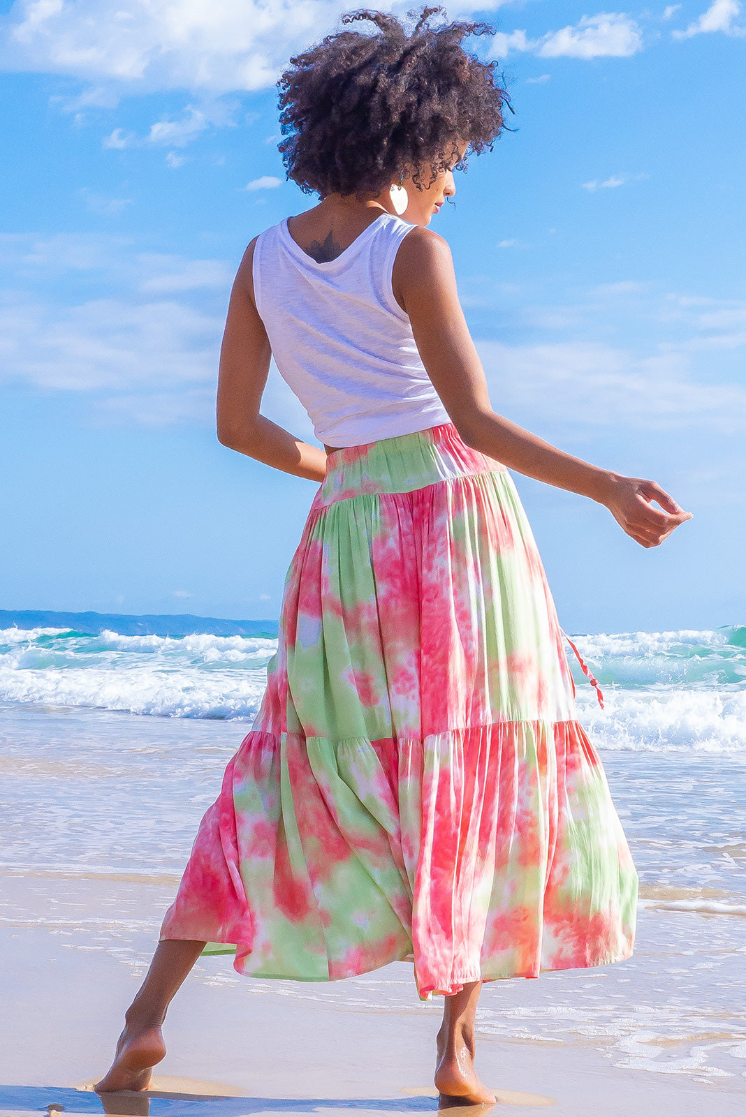 Summer must-have skirt is here, the Valencia Watermelon Tie Dye Maxi Skirt features elasticated waistband with decorative tie, side pockets and 100% rayon in tie dye print of green and watermelon red.