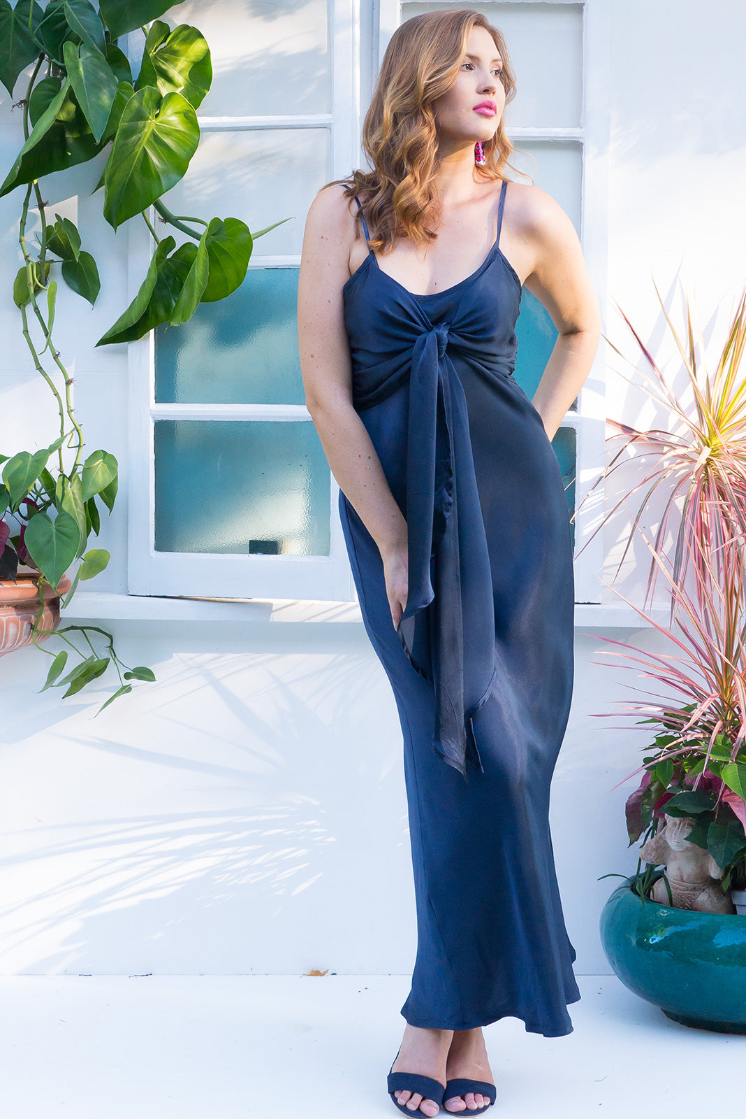 Venus Midnight Blue bias cut satin crepe maxi dress with a front tie and adjustable straps in dark navy