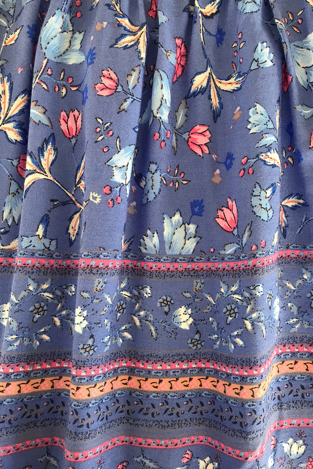 Fabric swatch of Viva Highway Blues Dress featuring 100% rayon in smoky blue base with pretty florals.