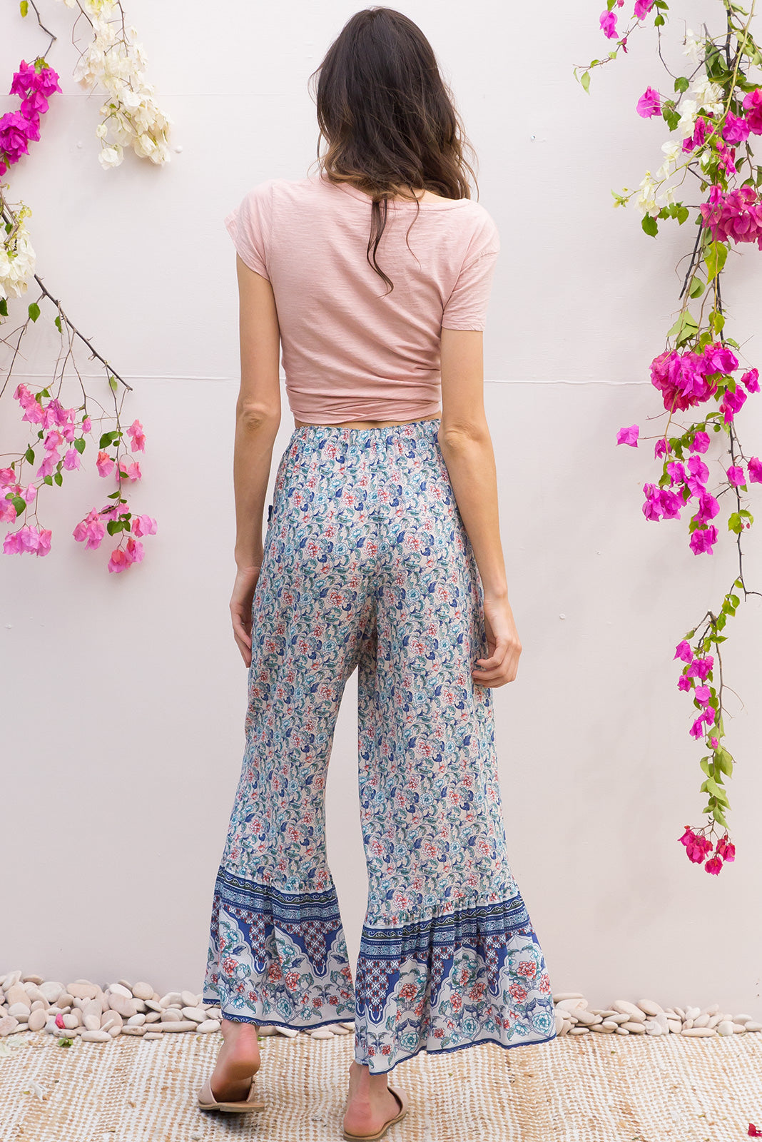 Wandering Bliss Blue Pants feature a slim leg with a wide frill around the hem for a retro vintage style, boho inspired border print design is printed onto woven rayon
