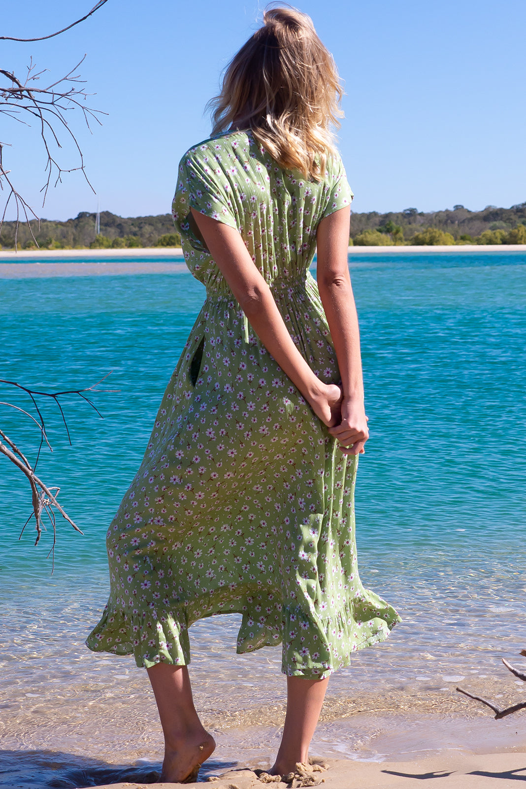 The Willow Green Goodness Maxi Dress features elasticated waist with adjustable drawstring waist, frill hem and crinkle textured woven 100% rayon in pale green base with cute daisy print.