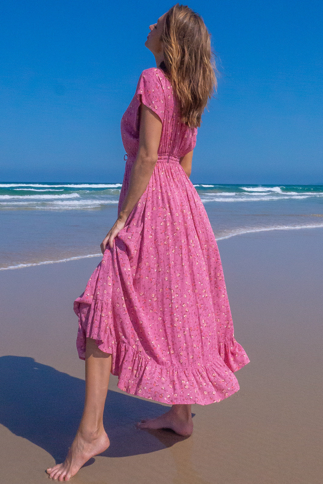 The Willow Pink party Maxi Dress features V-neck with lace feature, cap sleeves, elasticated waist with adjustable drawstring, frill hem and crinkle textured 100% rayon in rich pink base with ditzy floral print.
