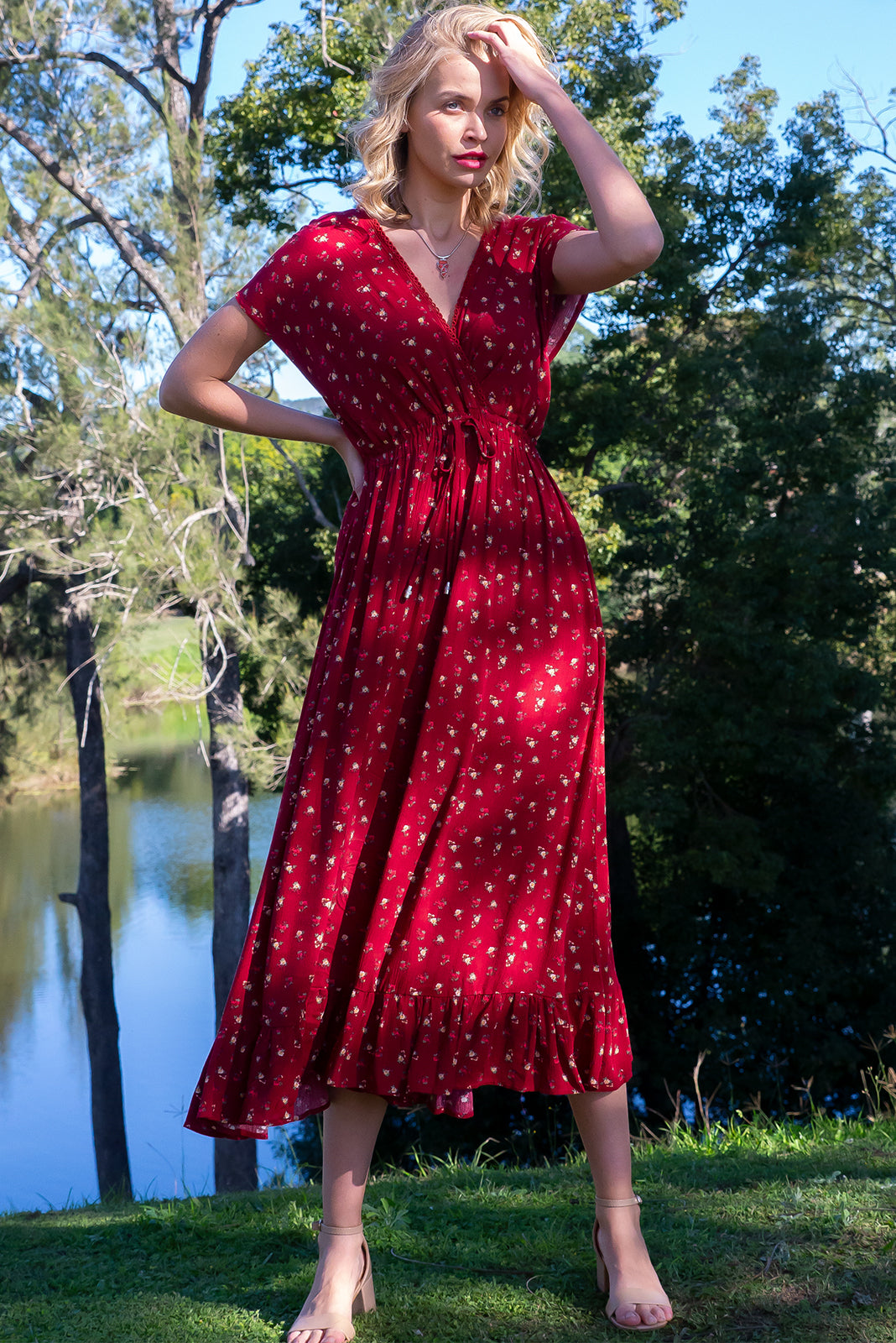 Willow Rust Berry Maxi Dress features V-neck with lace feature, Cap sleeves, elasticated waist with decorative centre tie, frill hem and textured woven 100% rayon in deep red base with antique floral print.