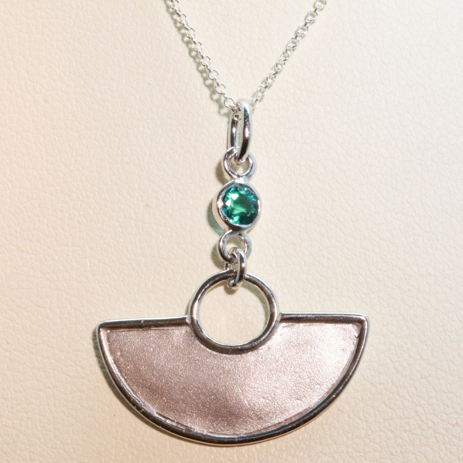A stunning African Style 925 silver pendant with a Tourmaline Shard which hangs perfectly through a silver circle.