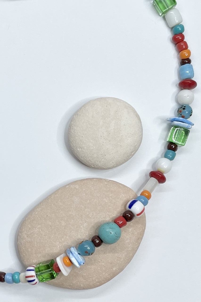 New Necklace Cay Island Afriki is a sweet choker style hand made using random choice of glass and shell beads in bright beachy colours.