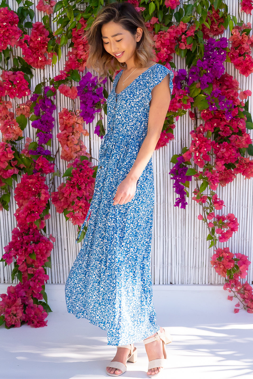 The Juniper French Dee Maxi Dress features functional button down detailing to waistline, side pockets, adjustable drawstring waist and woven 100% viscose in blue base with white floral print.