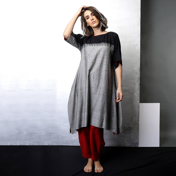 Contemporary Sustainable Fashion from Indian designer wear label O Layla. Kaaya kaftan tunic with Niko pleated pants. Handloom textiles.