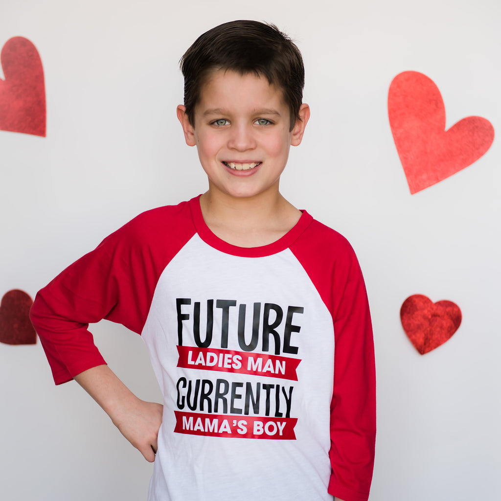 Boy wearing red sleeve raglan that says future ladies man in red and black