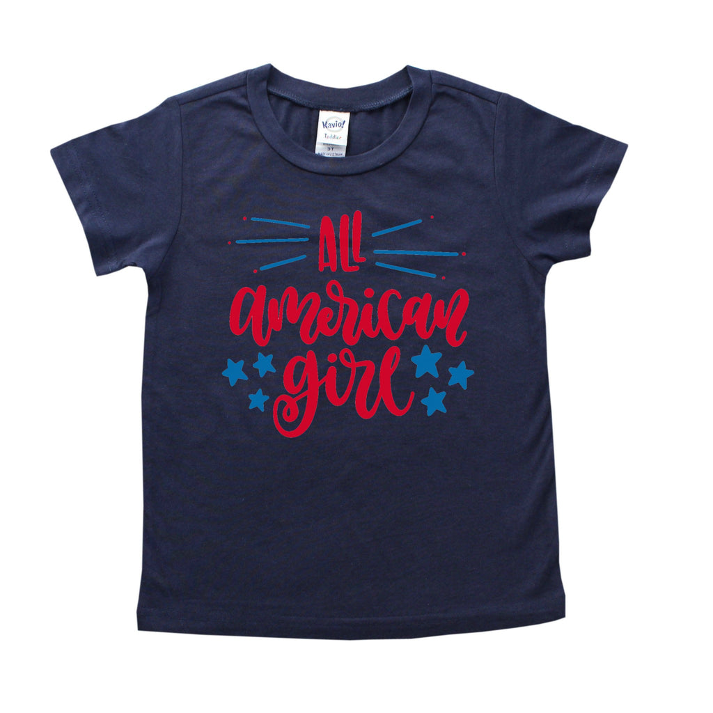 Navy Blue shirt with all american girl written in red with lighter blue stars