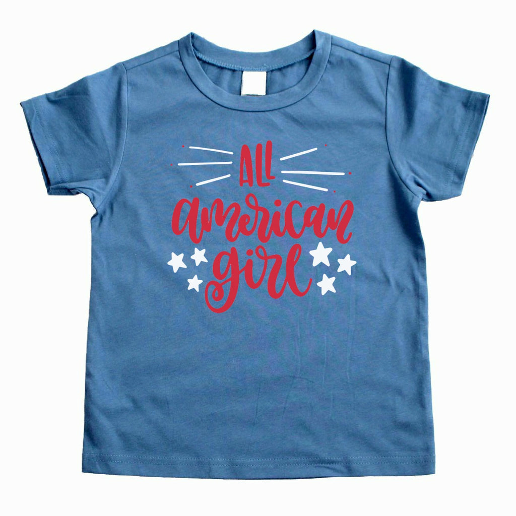 Steel blue shirt with all american girl written in red with white stars