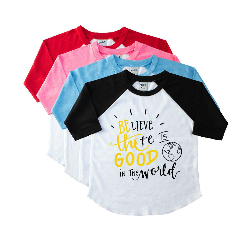 Kids' black sleeve raglan with Believe there is good in the world in yellow and black on the front