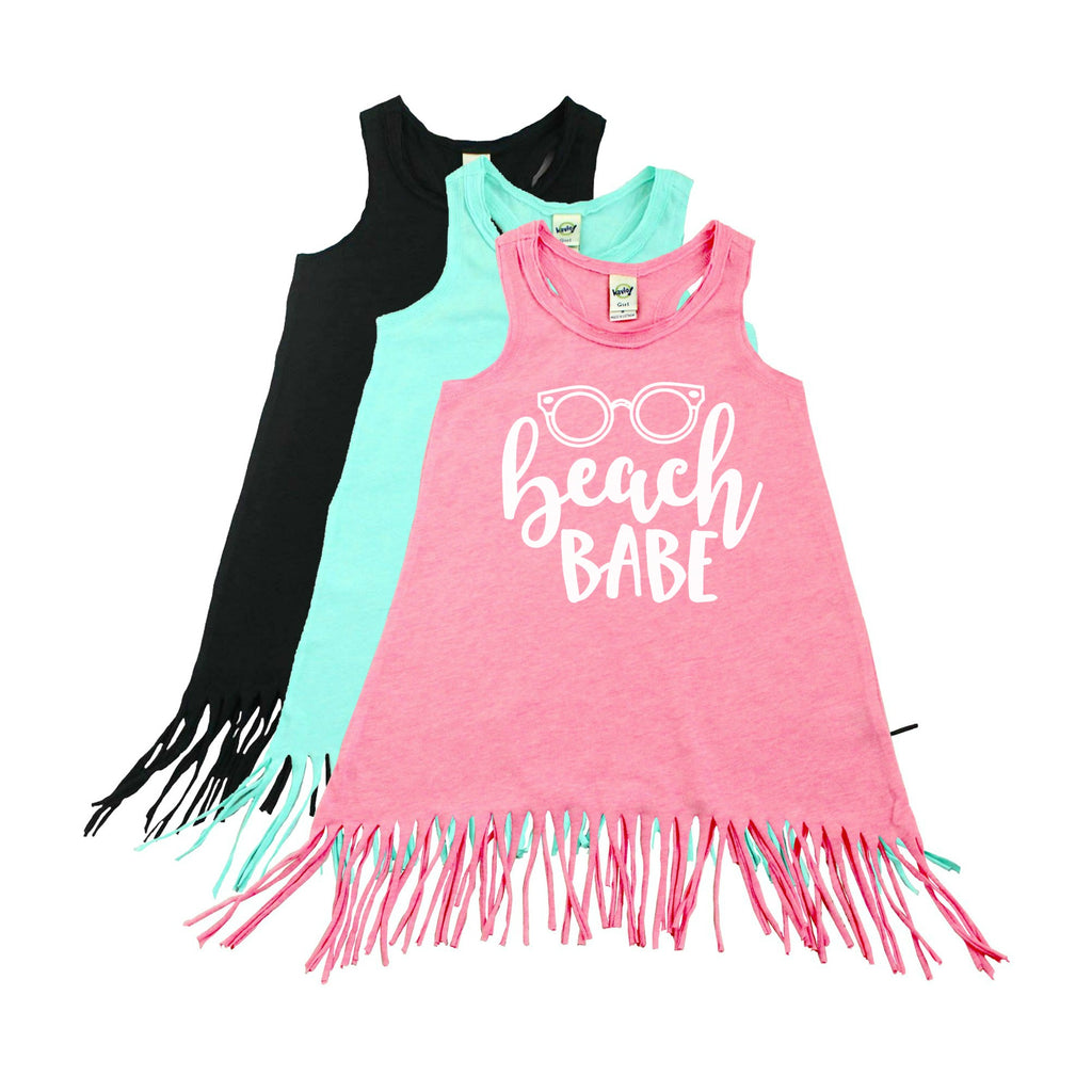 Pink fringe dress with beach babe written in white
