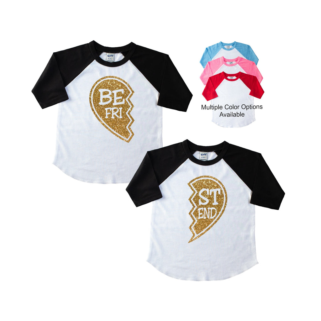 Two black sleeve children's raglan tee each with half of a best friends heart in gold glitter