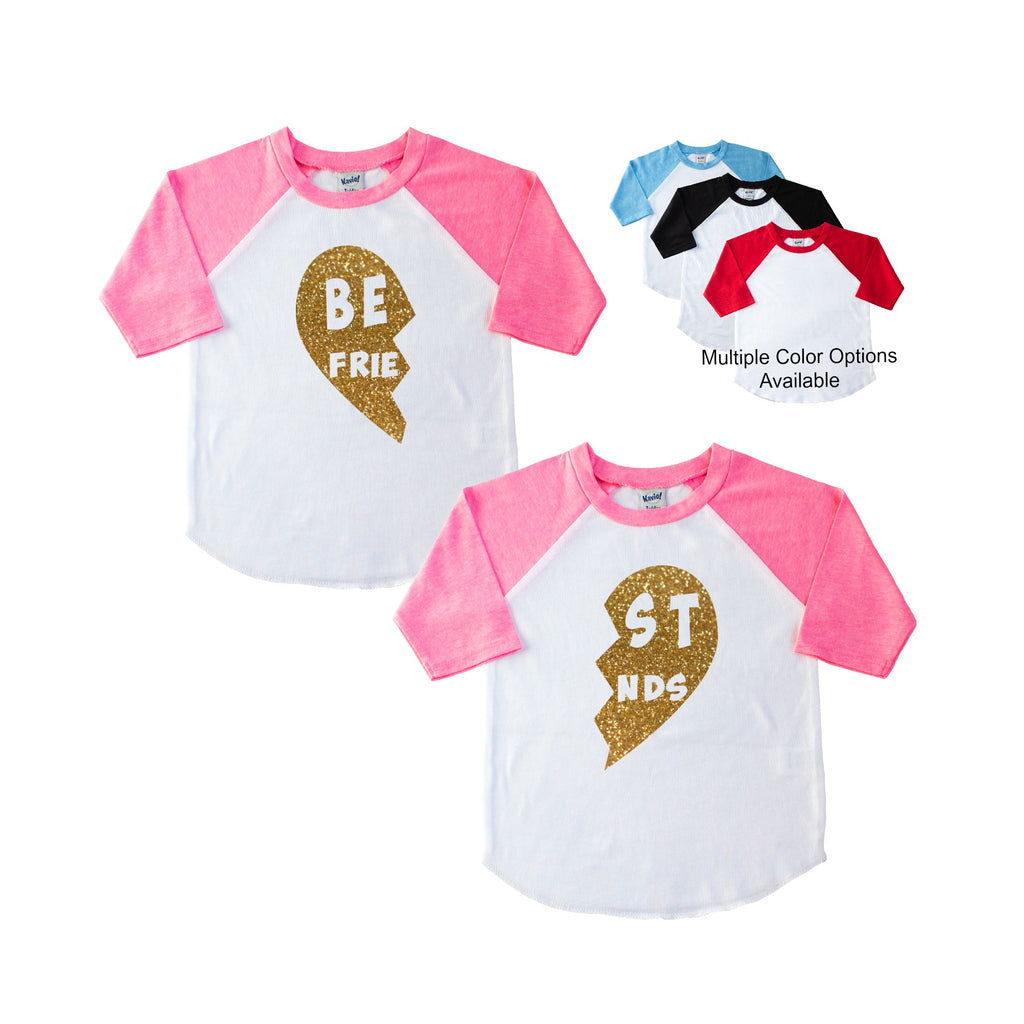 Pink sleeve raglan set each with half of a gold glitter heart that says Best Friends