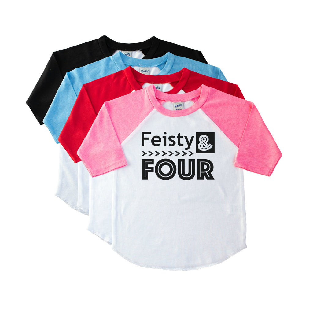 Pink sleeve youth raglan tee atop a stack of shirt colors with Feisty and Four in black on the front