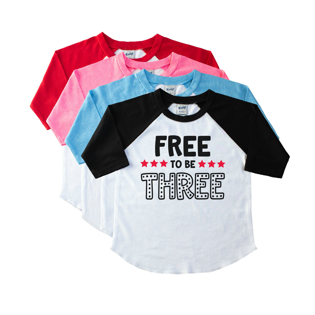 Toddler black sleeve raglan with Free to be Three in Black with red stars on the front