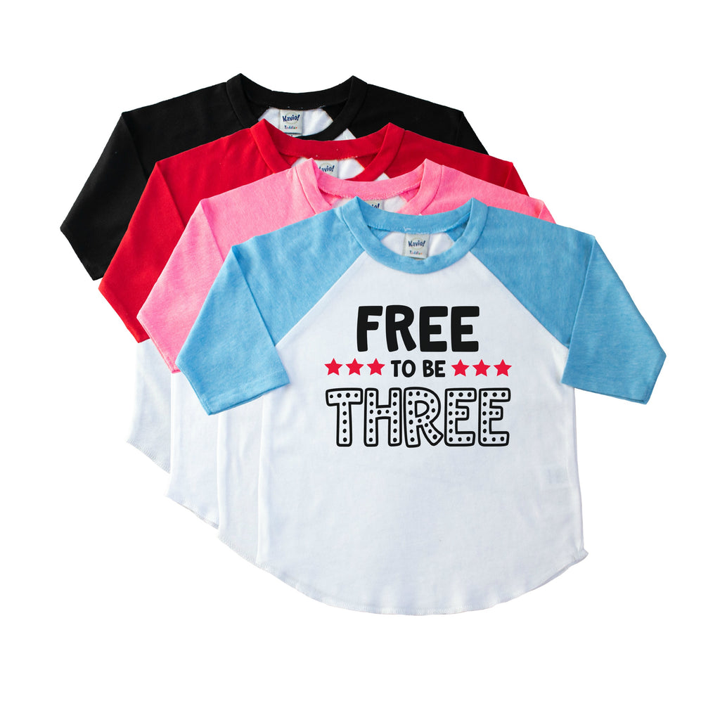 Blue sleeve toddler raglan with Free to be Three on the front in black with red stars