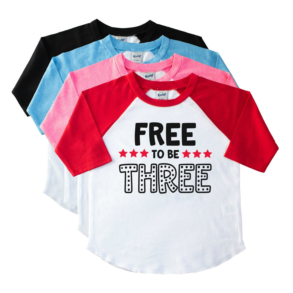 Toddler red sleeve raglan tee with Free to Be Three in black with red stars on the front