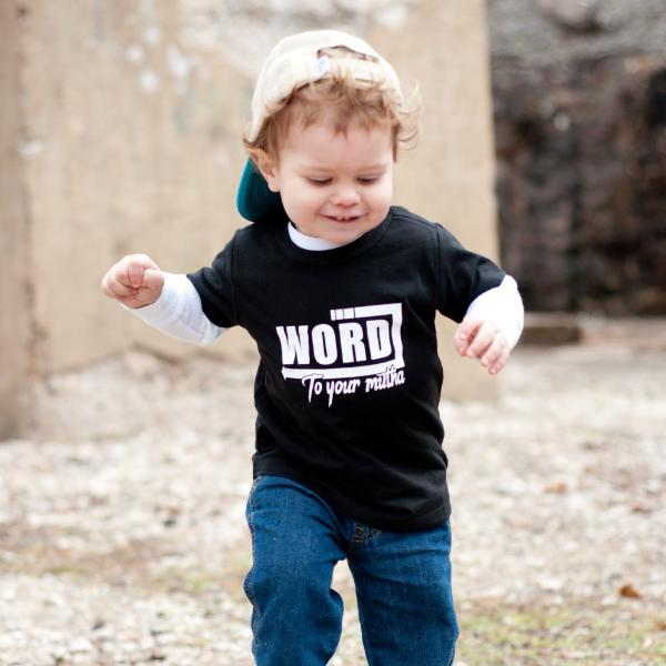 Toddler boy wearing black tee that says Word to your mutha in white