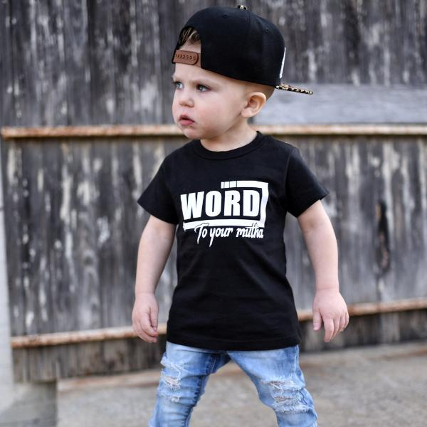 Little boy wearing black tee that says Word to Your Mutha in white
