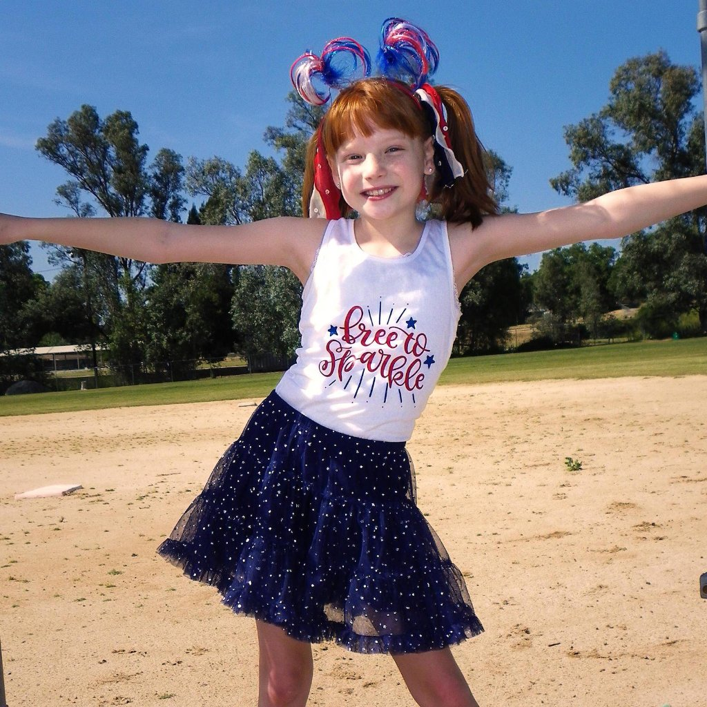 Little girl wearing racerback tank with free to sparkle in red and blue