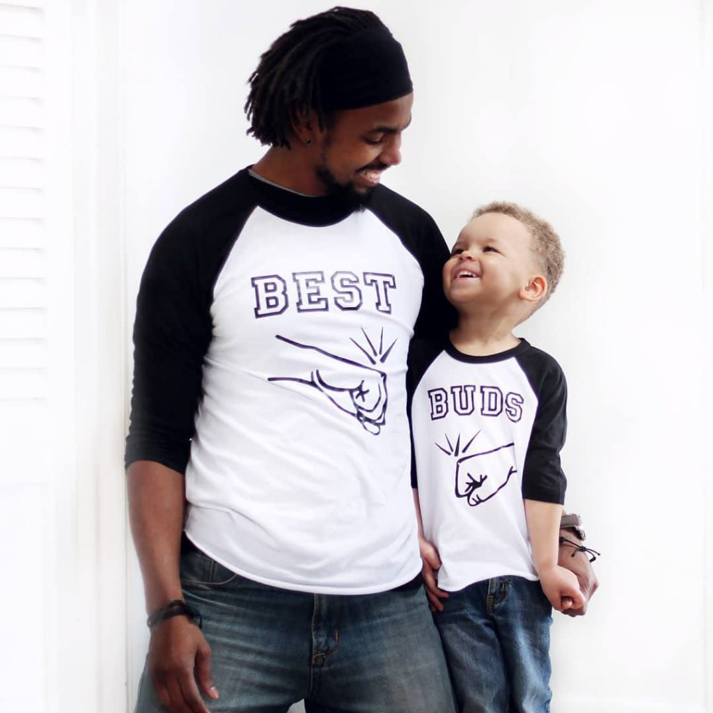 Father and son wearing matching best buds fist bump shirts