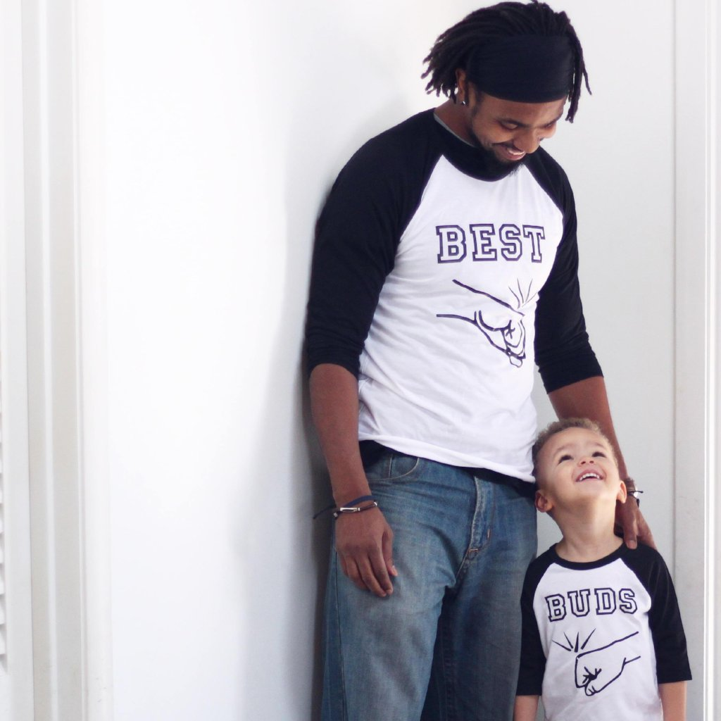 Adult and child wearing matching best buddies black sleeve raglan tees