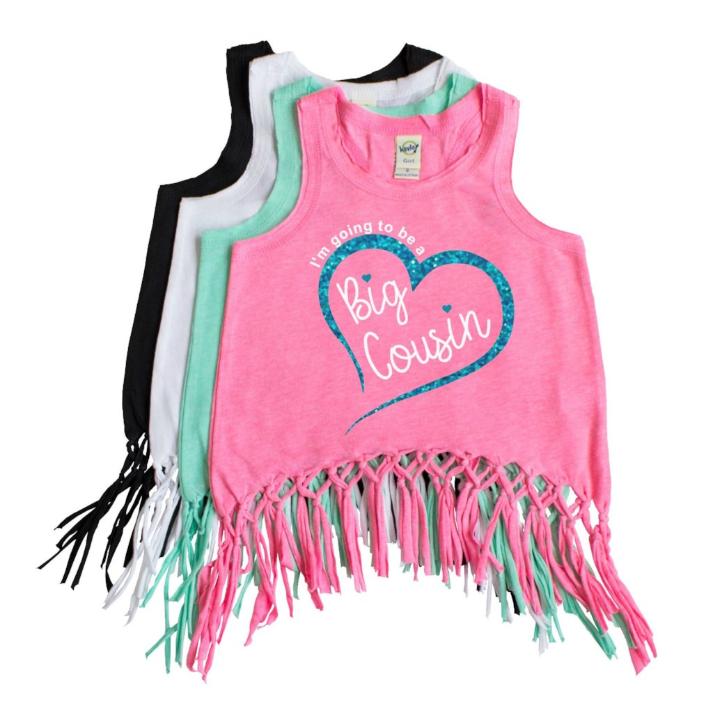 Pink fringe tank with I'm going to be a big cousin in white with aqua glitter heart