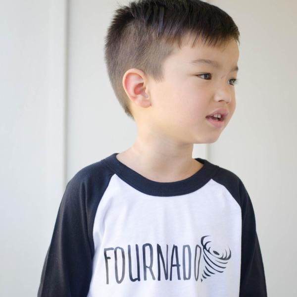 Little boy wearing black sleeve raglan with fournado in black