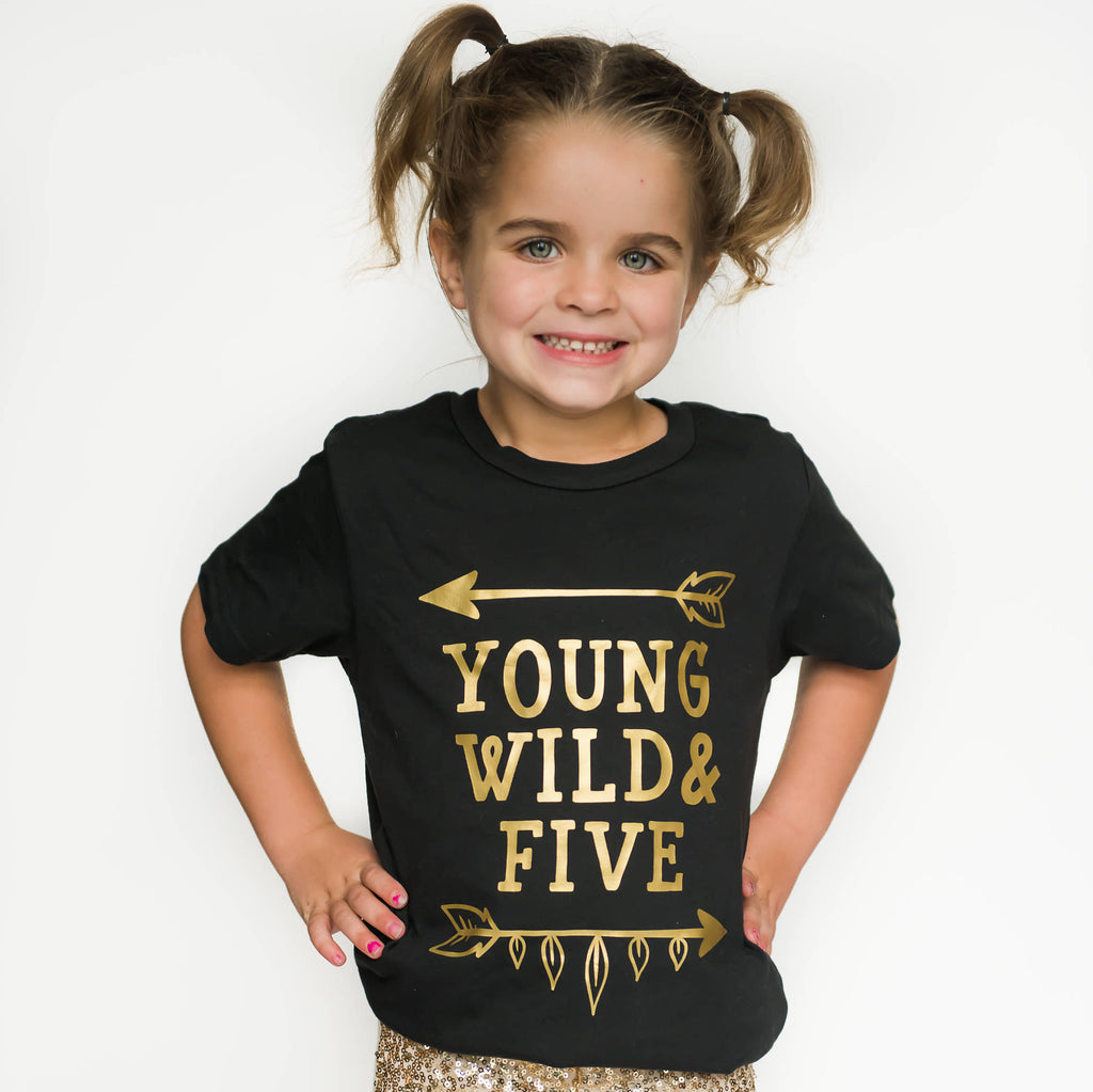 Little girl wearing black young wild and five tee with gold writing
