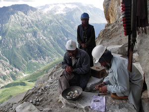 Miners at 2000-3000 ft. elevation mining gems in Himalayas