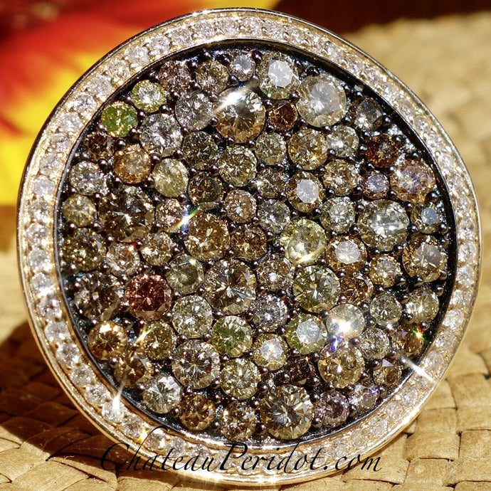 Pink, champagne, cognac, yellow, orange diamond ring.