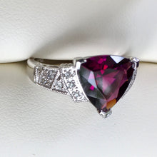 Plum colored gems include garnet and sapphire. Amethyst may have plum tones but seldom main hue.